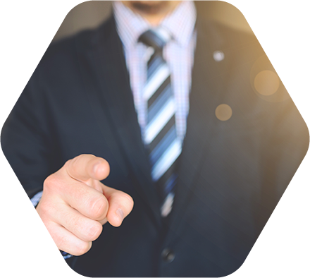 figure in suit pointing towards viewer